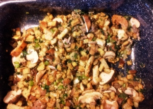 "Then mix in sliced mushrooms, chopped spinach, wild rice and barley... I prefer stuffing that is not ""wet."""